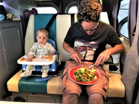 Alasdair and baby Emilia eating in camper (2).jpg