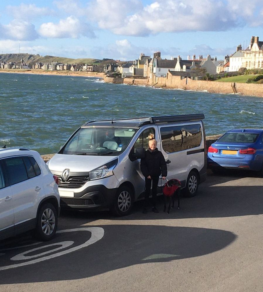 Sylvie and campervan Elie Village where student Hugo played cricket on beach and pub as pavilian.jpeg