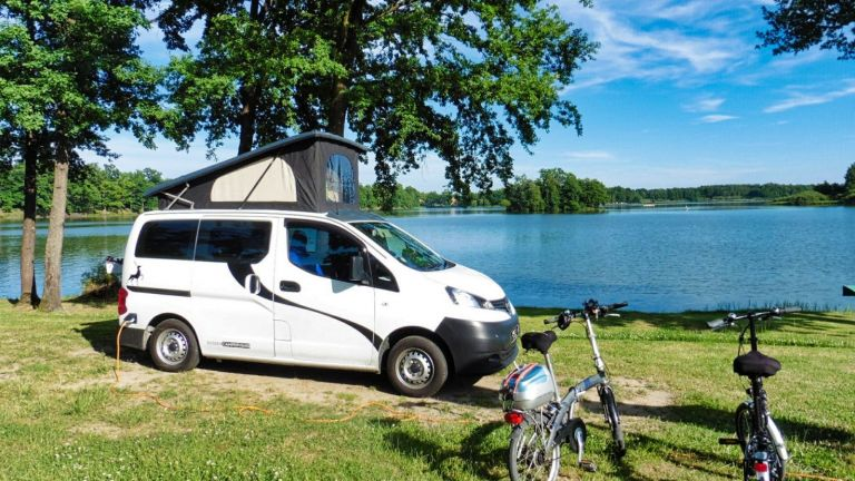 Nissan NV200 CamperCar Sussex Campervans lake with bikes.JPEG