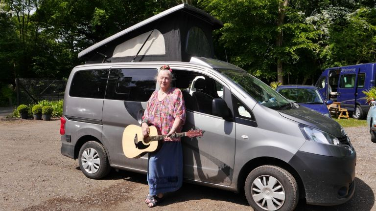 7.  Sussex Campervans NV200 compact camper Ruth festival storyteller guitar.JPG